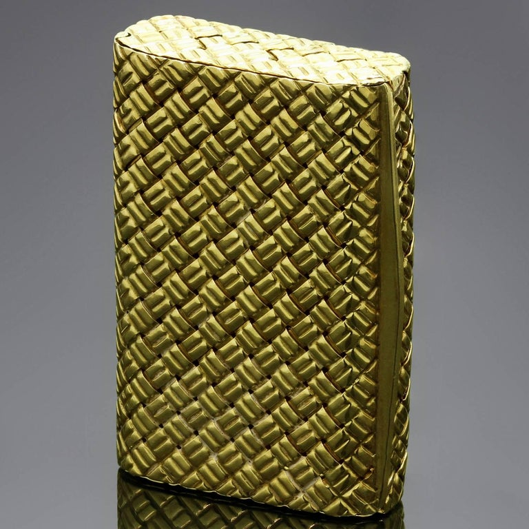 "This fabulous Objets d'Art piece from Van Cleef & Arpels Objets d'Art is a fully functional pill box featuring a beautiful woven pattern crafted in 18k yellow gold. Made in France circa 1950s-1960s. Measurements: 1.10"" (28mm) width, 1.57"" (40mm)"