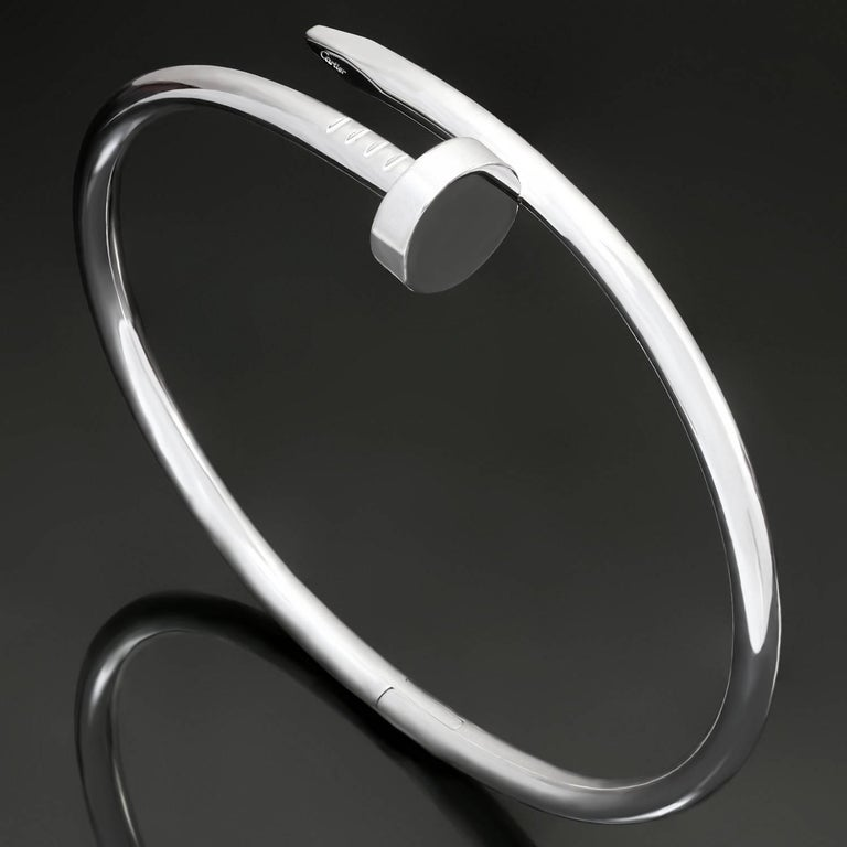 This chic hinged bracelet from Cartier's iconic Juste Un Clou collection is elegantly crafted in 18k white gold. This bangle is a size 18. Made in France circa 2016. Excellent condition. Comes with original box and paperwork.