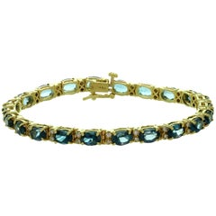 Blue Topaz Diamond Yellow Gold Oval Link Bracelet