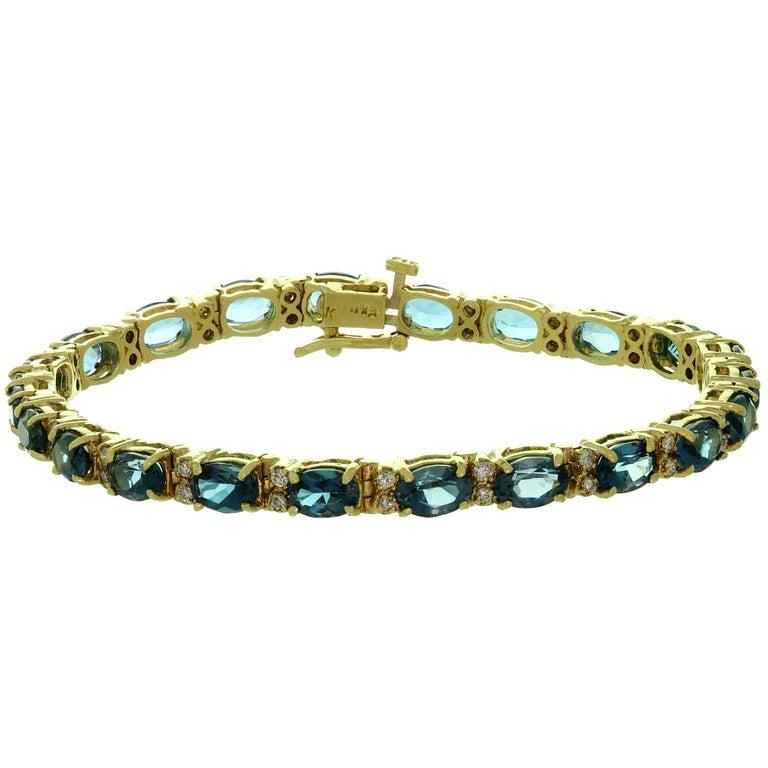Blue Topaz Diamond Yellow Gold Oval Link Bracelet