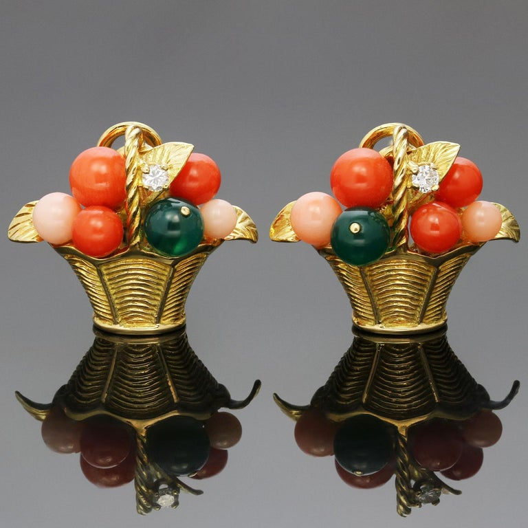 These gorgeous and rare vintage Van Cleef & Arpels earrings feature a vibrant floral basket motif crafted in 18k yellow gold and set with bouquet of colorful beads and  brilliant-cut round diamonds of an estimated 0.12 carats. The corals beads
