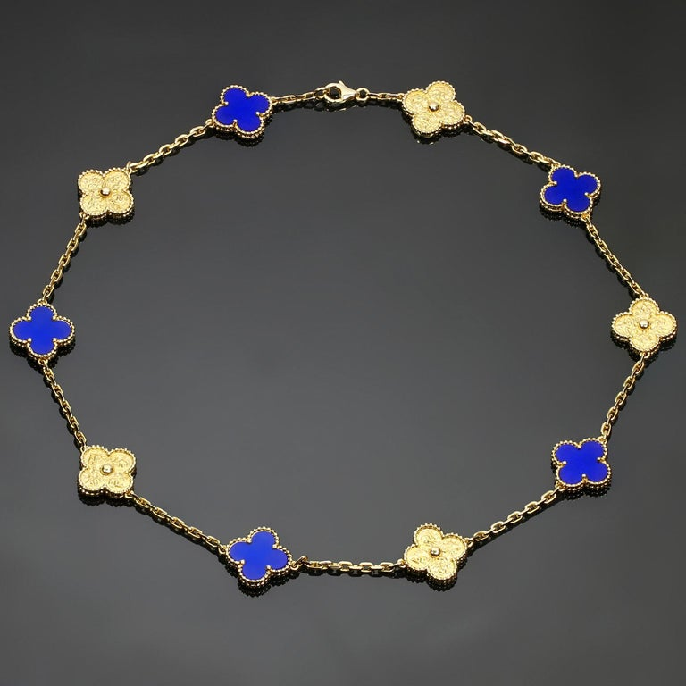 This rare and fabulous Van Cleef & Arpels necklace from the iconic Vintage Alhambra collection features 10 lucky clover motifs crafted in textured 18k yellow gold and inlaid with lapis lazuli in five of the charms. Made in France circa 2010s.