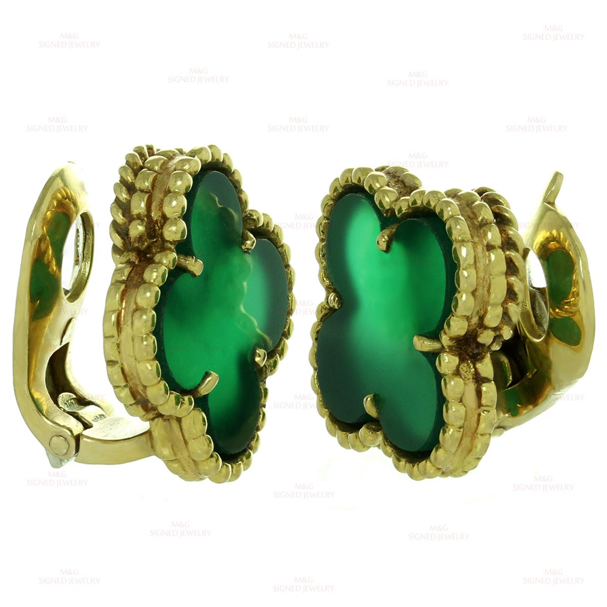 """These stunning Van Cleef & Arpels clip-on earrings from the vintage Alhambra collection feature the lucky clover design crafted in 18k yellow gold and set with green chalcedony stones. Made in France circa 1970s. Measurements: 0.59"""" (15mm)"""