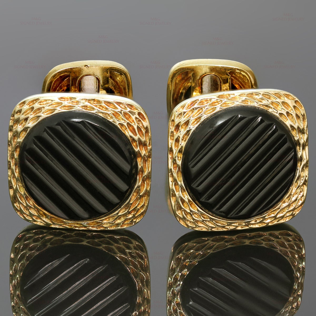 "These elegant vintage Van Cleef & Arpels cufflinks feature a textured square design made in 18k yellow gold and set with ridged round black onyx stones. Made in France circa 1970s. Measurements: 0.70"" (18mm) width, 0.70"" (18mm) length."