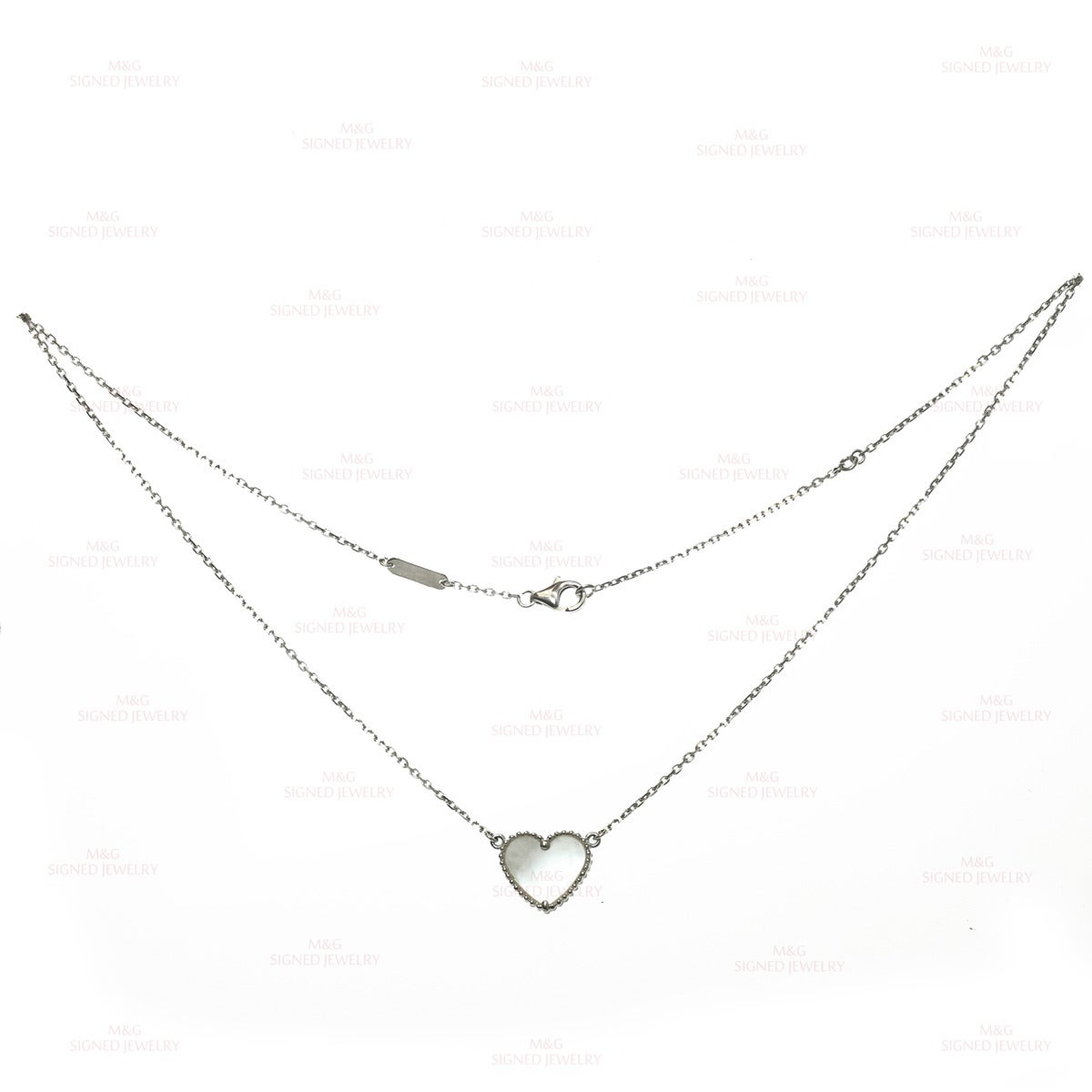 This romantic Van Cleef & Arpels necklace is made in 18k white gold and accented with a heart-shaped mother-of-pearl pendant. Made in France circa 2000s. Measurements: 0.47