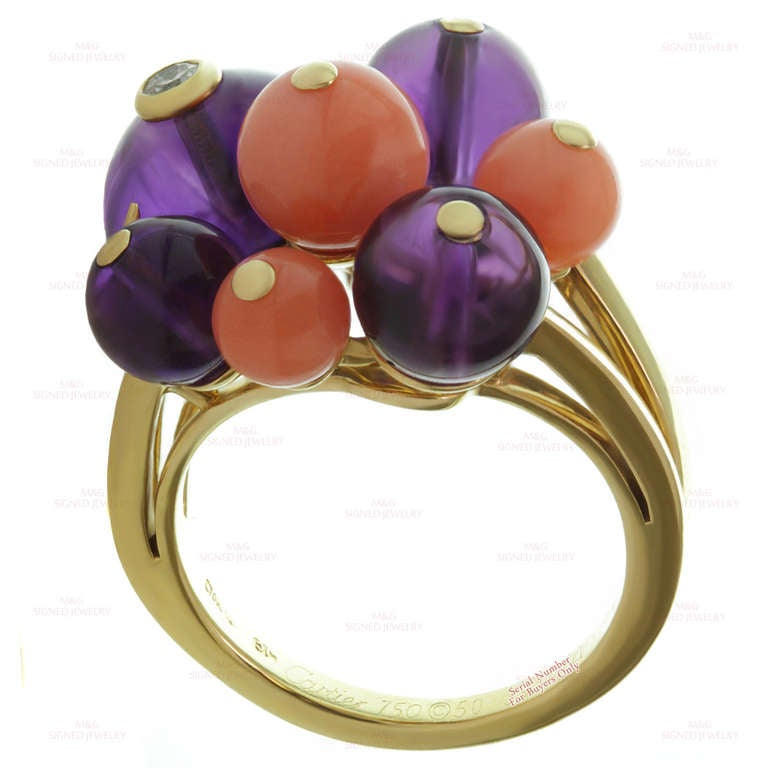 This stunning ring from Cartier's Les Delices de Goa collection is made in 18k yellow gold and features a cluster of 4 amethyst beads and 3 rose coral beads accented with a solitaire bezel-set brilliant-cut F-G VVS2-VS1 diamond of an estimated 0.08