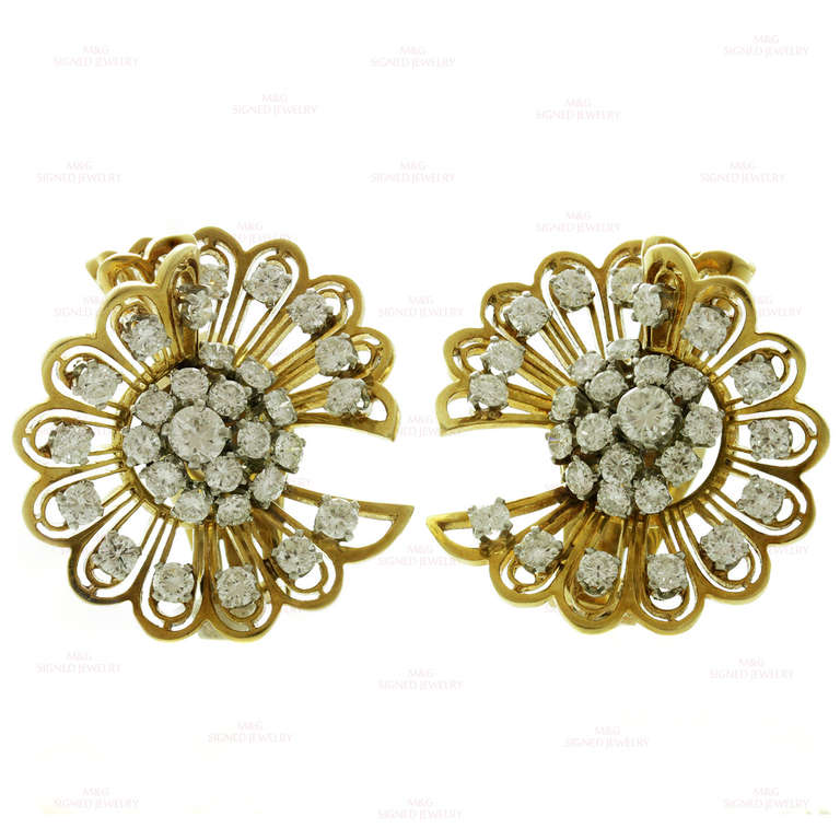 These retro Van Cleef & Arpels clip-on earrings are made in 18k yellow gold and prong-set in fine platinum with brilliant-cut round F-G VVS2-VS1 diamonds of an estimated 5 carats. Can be worn as double brooches by raising a tiny pin tucked away