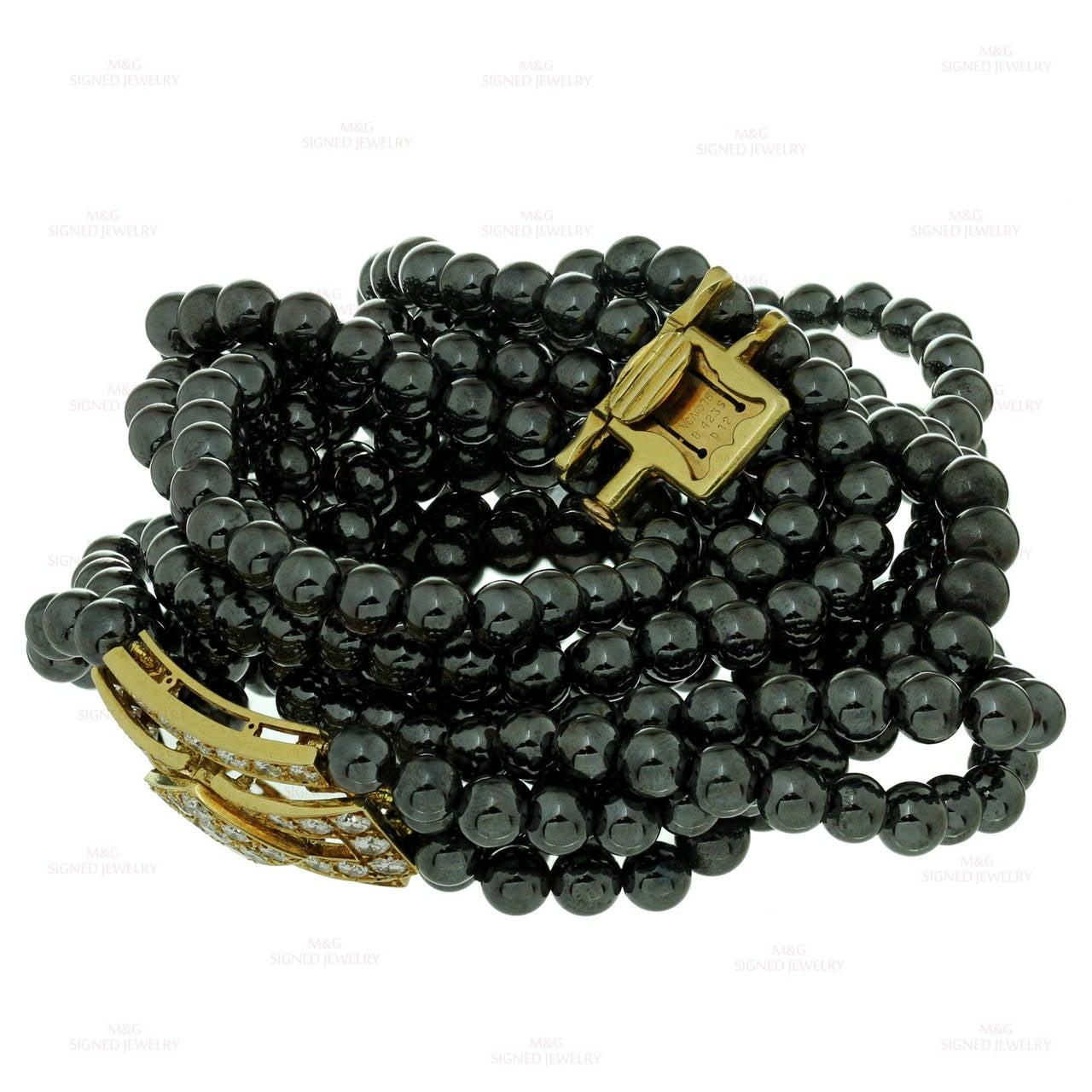 ... ARPELS Diam... Gold Hematite Beads
