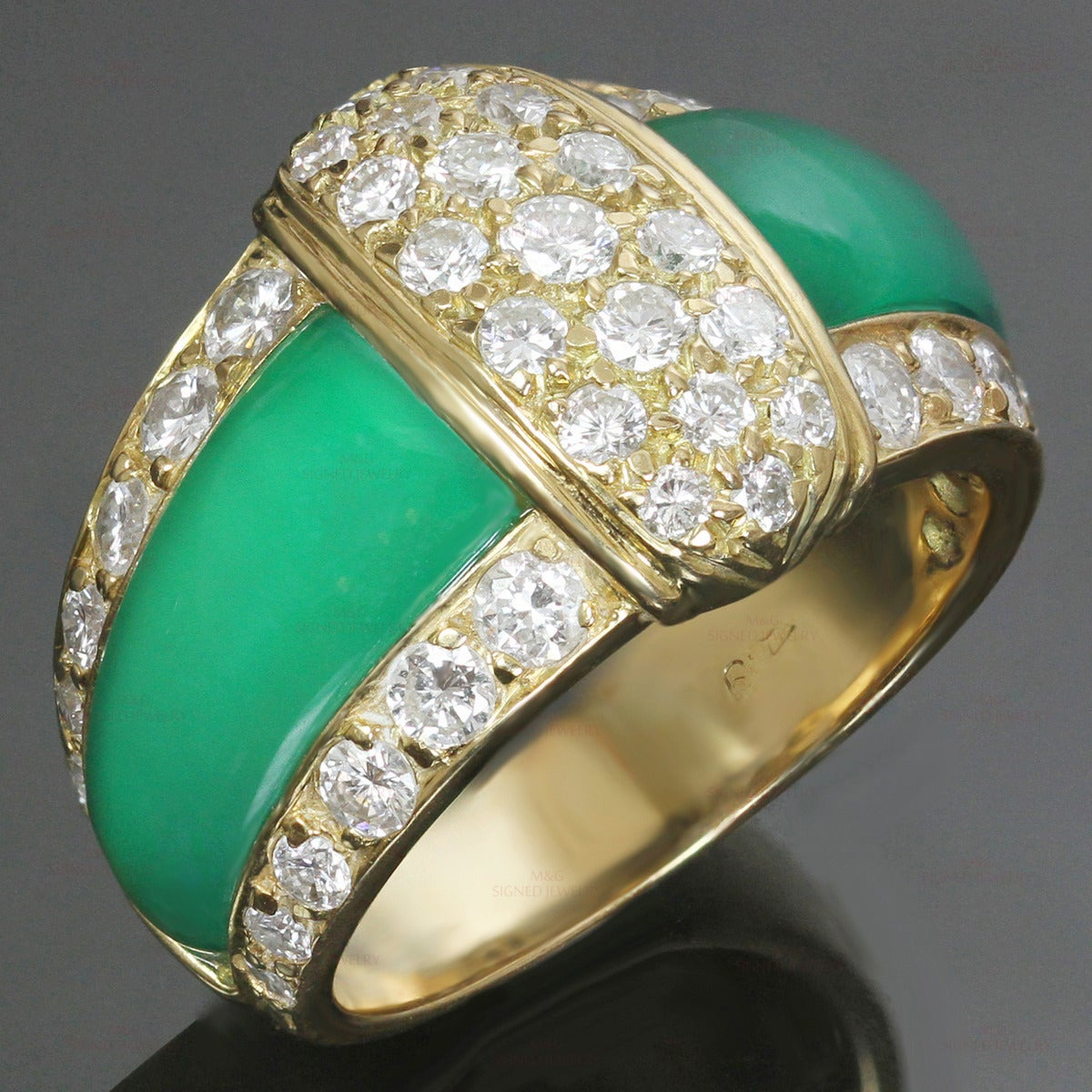 This stunning Van Cleef & Arpels ring features vibrant green chrysoprase inlays set in 18k yellow gold and beautifully accented with sparkling round brilliant-cut E-F VVS1-VVS2 diamonds of an estimated 1.38 carats. Circa 1988. 