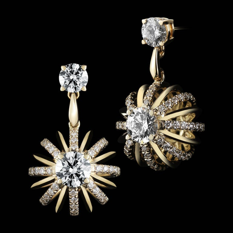 A pair of dangling snowflake Diamond earrings feature Round center GIA certified Ideal-cut Round Brilliant Diamonds. Carat weight, color and clarity is .43 and .44 carats, EVS2. Diamonds suspended by a pair of Brilliant-cut Diamonds totaling .49