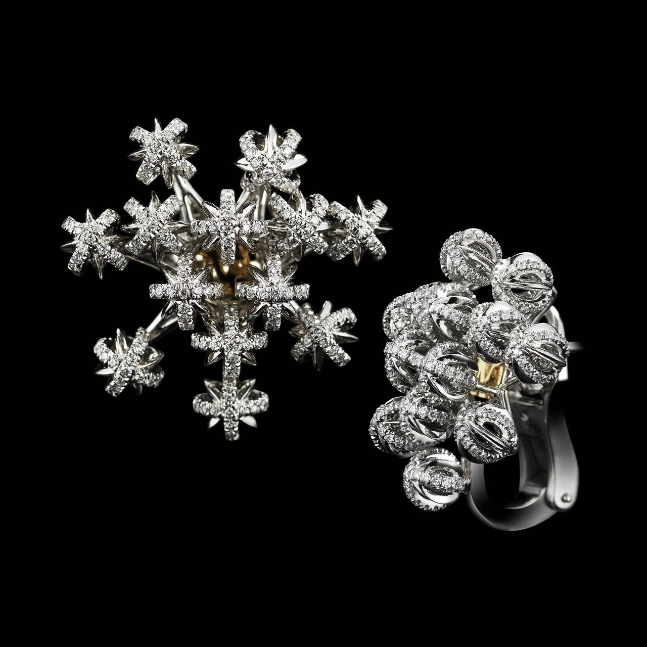 A pair of domed petite Diamond snowflake cluster earrings detailed with Alexandra Mor signature floating Diamond melee and knife-edged wire. Earrings are set in platinum on 18 karat yellow gold Alexandra Mor logo gallery. Earrings feature 754 round
