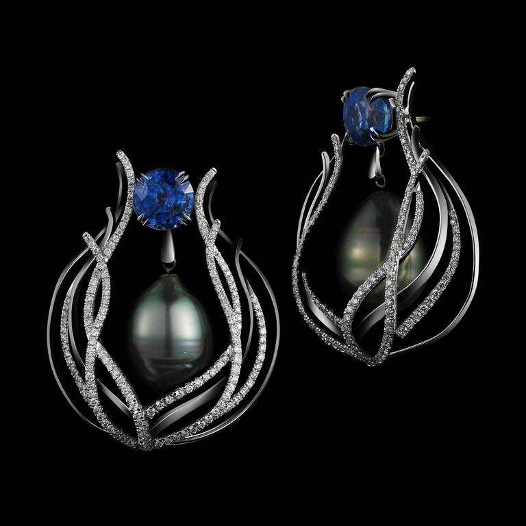*This design is available with center diamonds weighing from 1ct - 10 cts and larger.  Please contact us for more information on this piece or on creating your own custom Alexandra Mor Design.    A pair of Alexandra Mor one-of-a-kind curved earrings