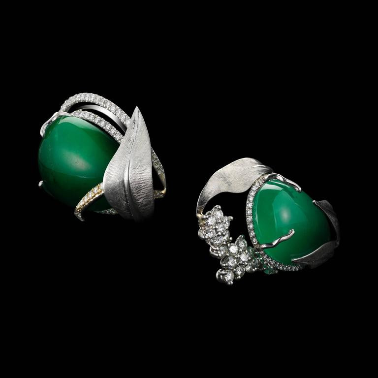 Dramatic, one-of-a-kind Alexandra Mor cuff earrings featuring matching Drop-shaped natural green Emeralds weighing 52.58 Cts. , encircled by Alexandra Mor's signature details of 1mm floating Diamond melee , and knife-edged wire. Earrings are further