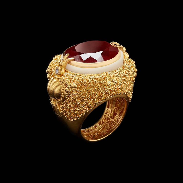 *Please contact us for more information on this piece or on creating your own Alexandra Mor custom Design.   This ring features an Oval-cut rich orange Spessartite Garnet weighing 24.40 Cts set in a 22 karat gold bezel accented with a carved,