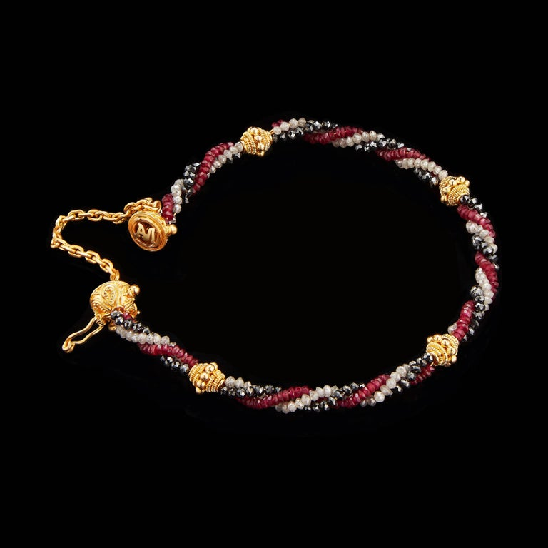 *Please contact us for more information on this piece or on creating your own Alexandra Mor custom Design.   This Alexandra Mor bracelet features 17 carats of black Diamond Beads, 16 carats of Ruby Beads and 11 carats of white Diamond Beads, woven