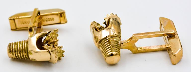 These interesting and masculine Oil Rig Drill Bit cuff links are made of 14kt yellow gold and have a three rotating bit base.  The cuff-links also have the screw attachment at the back of the drill design.  These Oil Rig Drill Bits are mounted on a