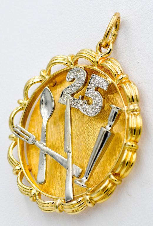 This Charm is ideal for a 25th anniversary gift! Set in 14K yellow and white gold, with the number 25 with round brilliant cut pave diamonds (0.15ctw with G-H color and VS clarity).  The charm also has a spoon, knife, fork, and candle stick all made