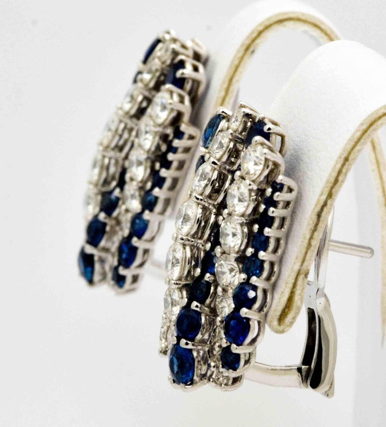 A pair of dazzking 18kt white gold blue sapphire and diamond earrings crafted by Leo Pizzo.  Leo Pizzo executed the earrings in a square design with four rows of prong set round brilliant cut sapphires alternating with three rows of round brilliant