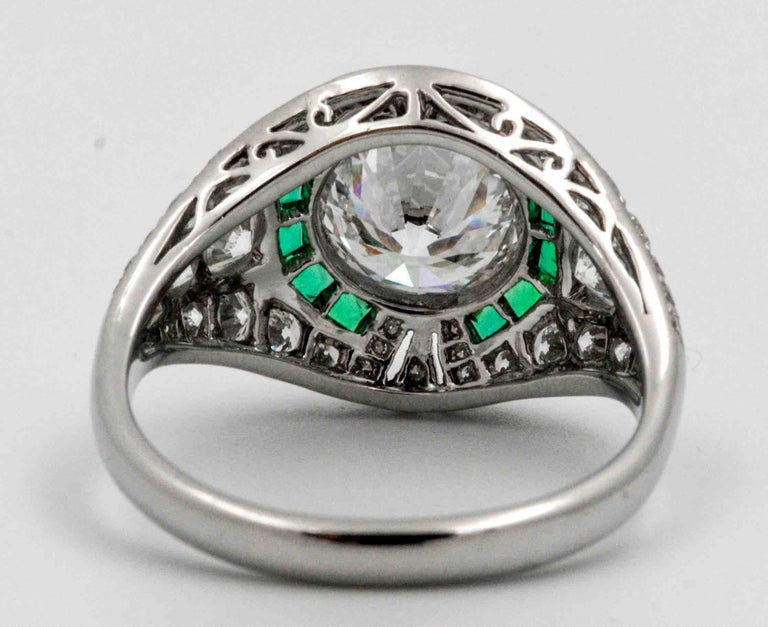 Art Deco 1.58 Carat Round Diamond Emerald Halo Engagement Platinum Ring For Sale