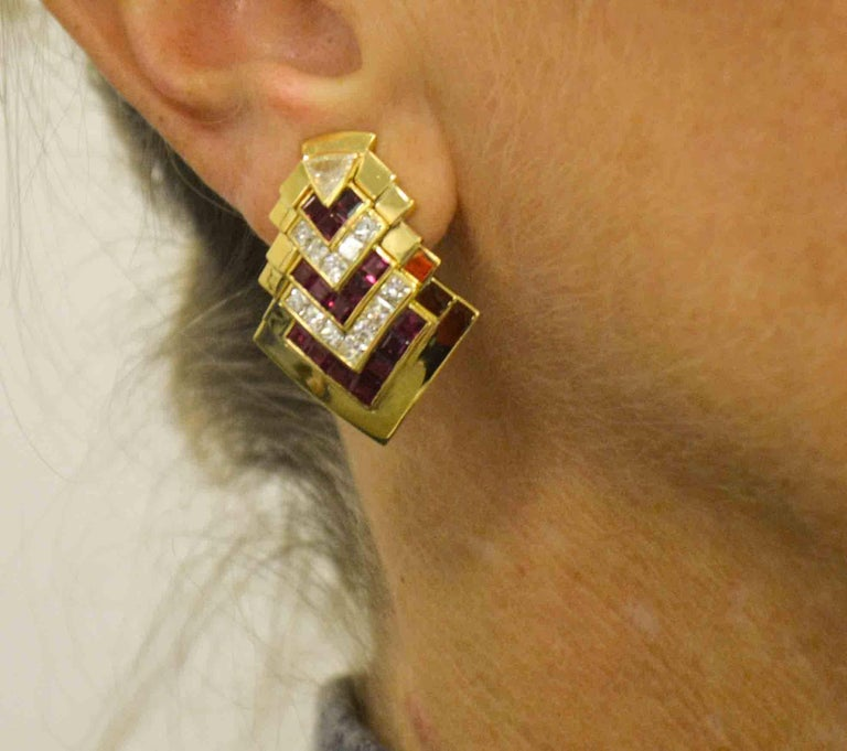 Allow your excellent taste to show in these 18 karat yellow gold Chevron clip-on earrings. Trillion cut diamonds are set at the peak of the earrings, princess cut diamonds (3.29 ctw H color, VS clarity) are tastefully set in channels along 30