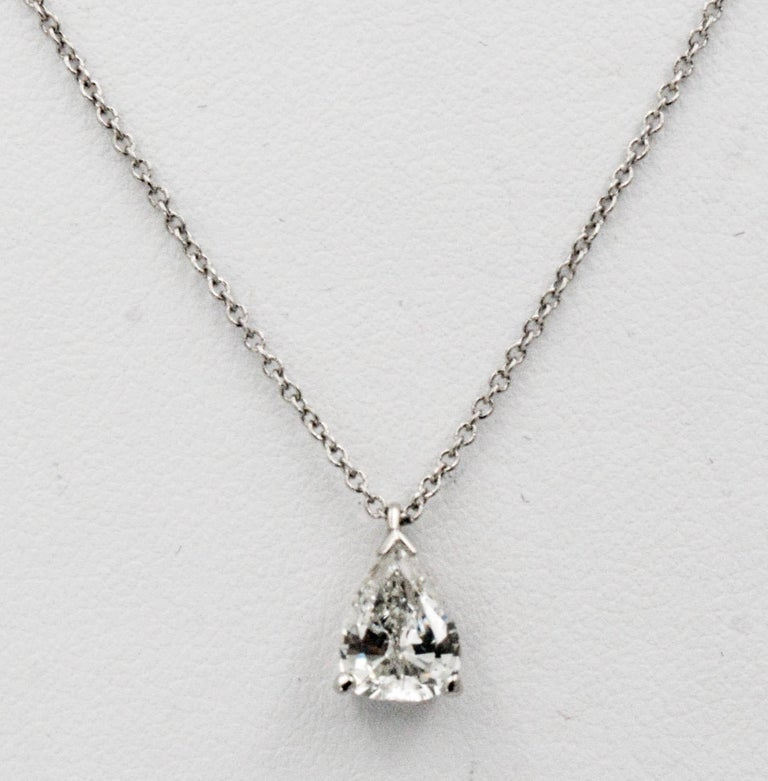 A stunningly simple Vintage Pear shape pendant hangs on a sublime platinum chain. You will want to wear this platinum necklace every day of the week! 0.83 carat vintage pear shape transition cut H color I1 internal clarity, no certificate. 18 inch