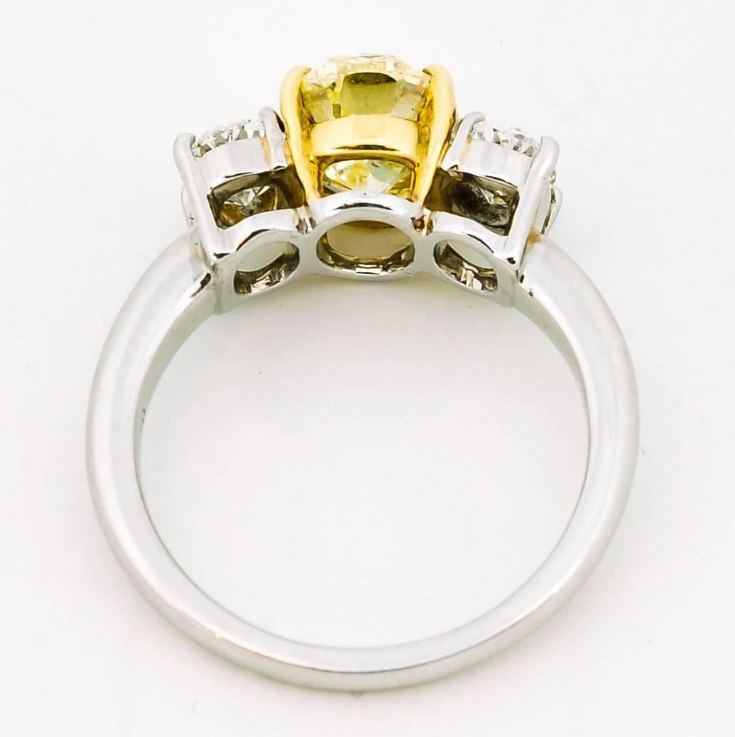 2 10 Carat Oval Fancy Yellow Diamond Gold Platinum Three Stone Ring at 1stdibs