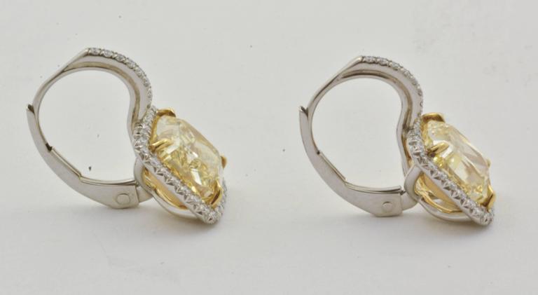 Modern 5.1 Carat Fancy Yellow Cushion Cut Diamond Gold Earrings For Sale