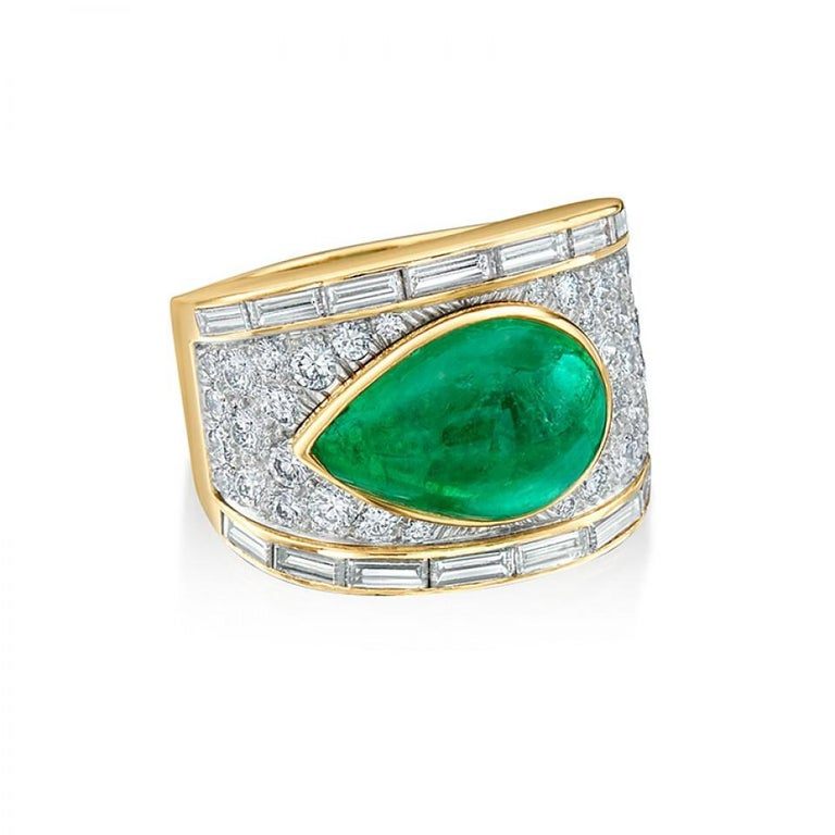 Exclusively from our Estate collection, comes an original dynamic ring from David Webb. David Webb is the quintessential American jeweler of exceedingly modern jewelry. Driven by art, design and bold pieces this Emerald ring embodies David Webb's