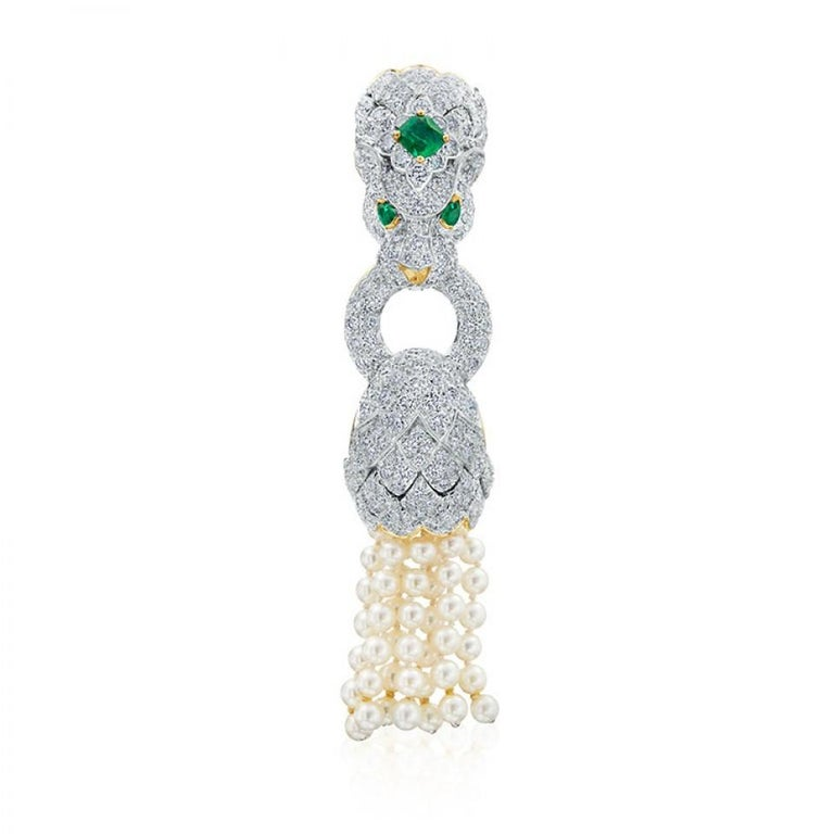 Driven by art, design and bold pieces this lion converting bracelet and brooch embodies David Webb's roaring and grand pearl statement. The bracelet is strung with seven strands of cultured pearls, the lion's head is surrounded with 256 pave round