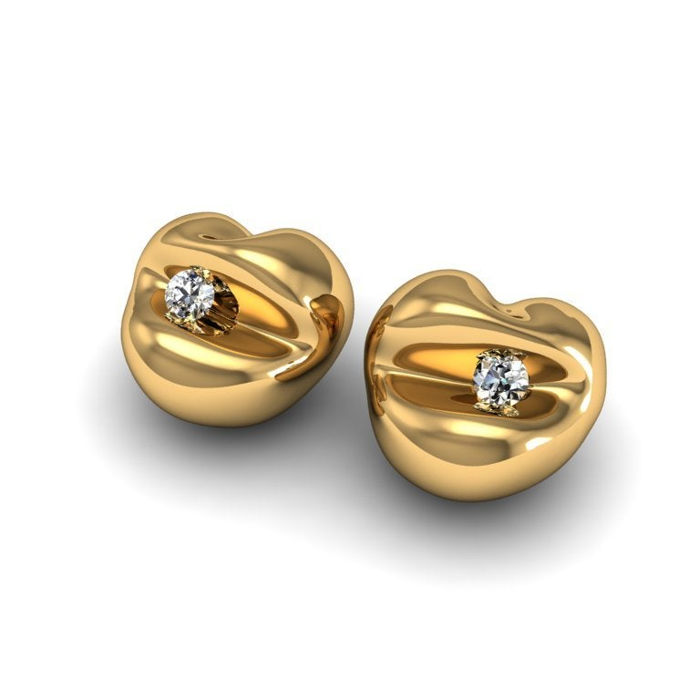 All the beauty of our Kiss Kiss earrings with its nod to contemporary art with the added glamour of a precious gem.
