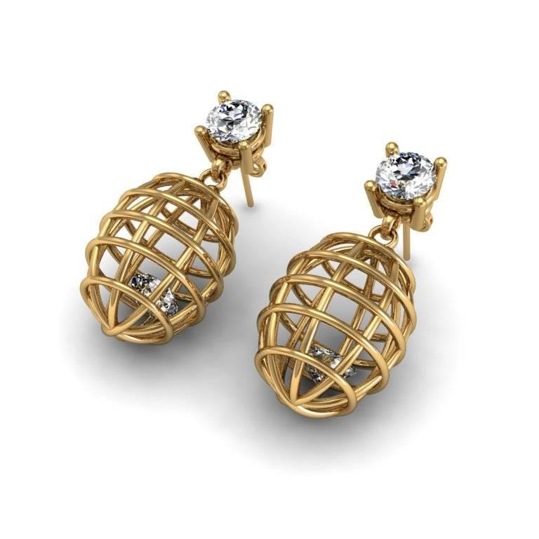 These earrings encase a precious gem within a caged setting to evoke an edgy atmosphere. This is a very cool and fashion-forward look for the modern woman.