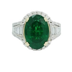 Oval 7.25 Carat Emerald and Baguette Diamond White Gold Ring