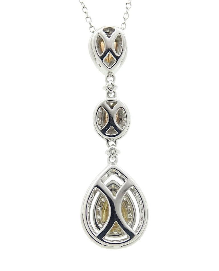 White gold fancy yellow light pink and blue diamond pendant this beautiful yet simple diamond pendant necklace has a gorgeous light blue tear drop diamond at aloadofball Images