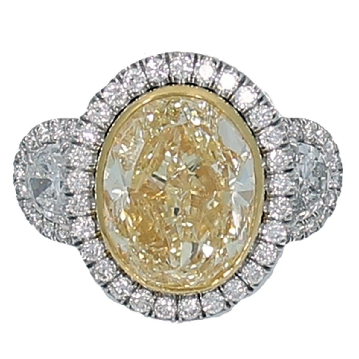 7.06 Carat Fancy Intense Yellow Oval Diamond Engagement Ring
