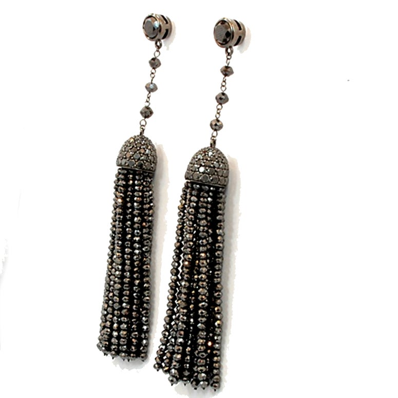 These beautiful earrings are from the Ivanka Trump Collection. They are Black Diamond Bead Tassel Earrings in Oxidized White Gold with a total of 8.40 carats in black diamonds. Exquisite workmanship and quality.