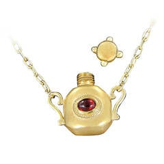 Gold Bottle Necklace with Red and Green Cabochon Stones