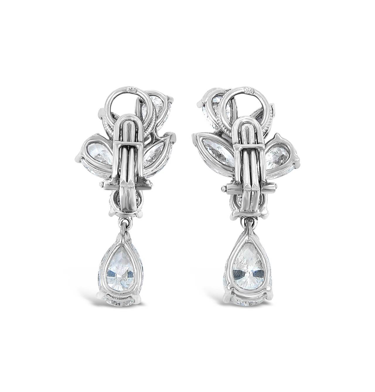 These impressive earrings have a total weight of approximately 5.16cts. Fine craftsmanship was used in putting together these earring. The lower pear shape diamonds rock back and forth for added sparkle. There are 2 marquise = .80ctw, 2 round =
