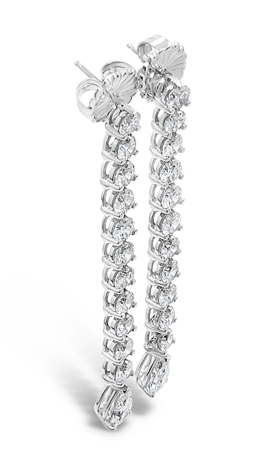 This pair of dangle earrings holds 22 round brilliant diamonds and 2 pear shape diamonds which equal approximately 7.50ctw. The matching round diamonds are all G-I in color and SI quality and set in a martini setting for maximum brilliance. Each