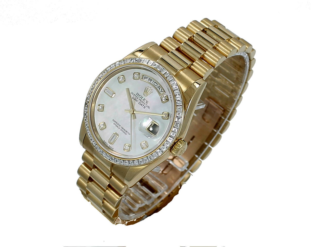 Rolex Oyster Perpetual Day-Date 36mm Watch in Yellow Gold. This beautiful Rolex has a Mother of Pearl Diamond Marker Dial and a 60 Baguette Diamond Bezel all original Rolex. It is Circa  2000, Serial#P190XXX. Watch has Box & Papers.