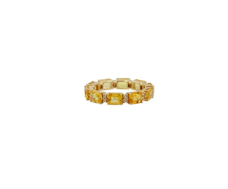 18K Yellow Gold Eternity Band with Ten Yellow Emerald Cut Sapphires and twenty Round Brilliant Diamonds. The yellow sapphires equal 4.94 carats and the diamonds equal .17 carats. The ring is a size 7 but available in other sizes.