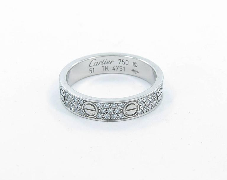 We are pleased to offer this beautiful estate Cartier love wedding band in 18k white gold. Set with 88 round brilliant cut diamond that equal 0.31cts. Ring is a size 51 (5.75 US). Ring is in great condition with minor scratches.