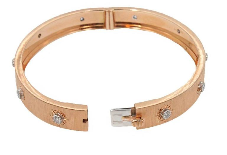 18K Rose Gold Buccellati Classica Bangle With 10 Round Brilliant Diamonds Surrounding The Band Weighing 0.49ct. This Bangle Fits a Size 6 Wrist.