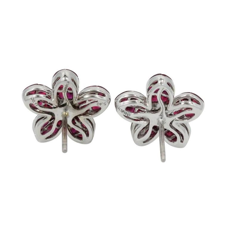 18K White Gold Daisy Earrings With 60 Rubies With a Total Carat Weight of 5.40ct and 14 Diamonds With a Total Carat Weight of .11ct.