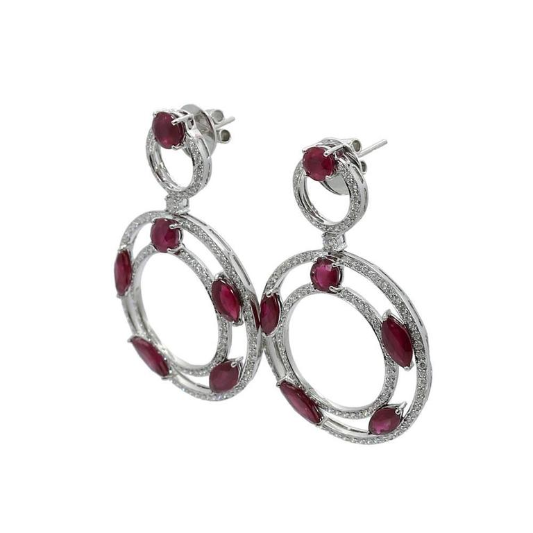 """We have these beautiful 18k white gold diamond and ruby dangle earrings.Rubies weigh approximately 13.27 carats total weightand the diamonds weigh 3.02carats total weight. They measure 2.125"""" in height with a total weight of 23.4 grams. The"""