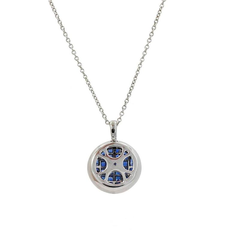 18K White Gold Pendant With Invisible Set Blue Sapphires Weighing A Total Carat Weight Of 2.30ct And Surrounding Diamonds Weighing A Total Carat Weight Of 0.17ct.