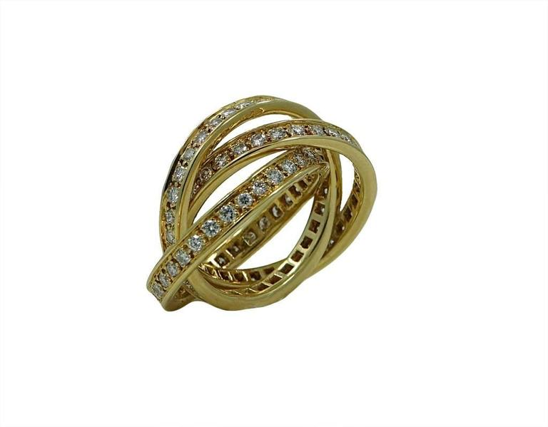 18K Cartier Yellow Gold Trinity Ring With Diamonds Weighing a Total Carat Weight Of 1.70ct. This Ring Is A Size 5.5.