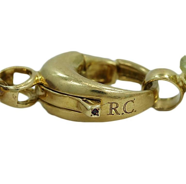 Roberto Coin 18K Yellow Gold Ipanema Bracelet with 8 semi precious colored stones. It measures 7 inches in length and weighs a total of 30.8 grams.The bracelet has the Roberto Coin Signature and is in excellent condition.
