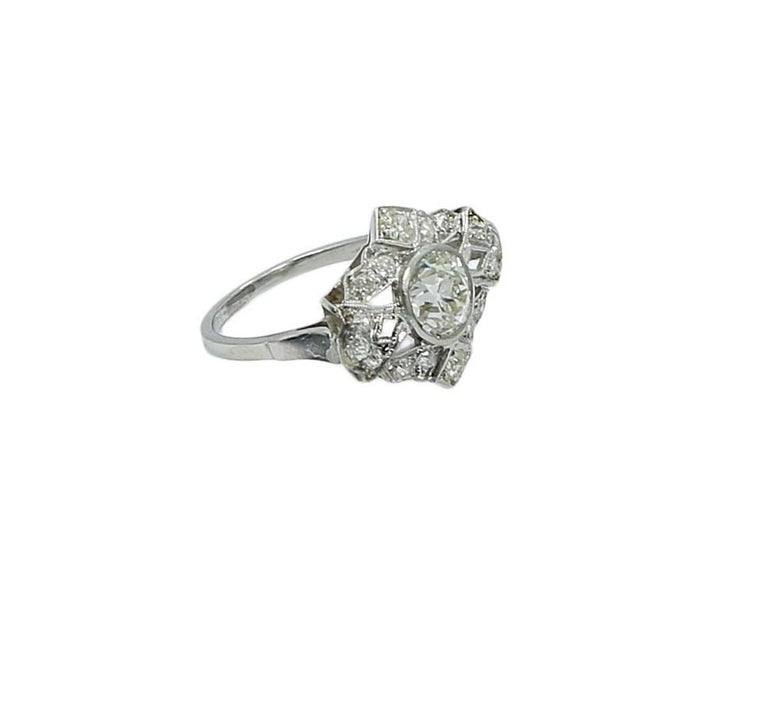 Art Deco platinum diamond ring. The diamond weighs approximately 0.95-1.00 carats total weight. The ring sits at a size 5.25 and weighs a total of 4.7 grams. The ring is in excellent condition. Please see all pictures and ask any questions you may