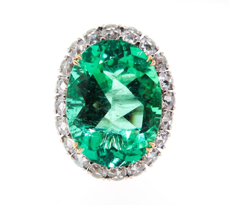 oval cut emerald and halo ring at 1stdibs