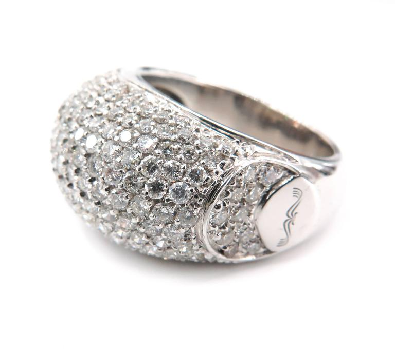 A magnificent cocktail ring featuring a slightly domed design set with the finest round brilliant cut diamonds in 18k white gold. A real statement ring 14mm wide, 28mm long and 7.5mm high.  Handcrafted in 18 karat white gold with pave set diamonds